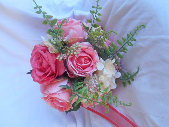 Brides round bouquet 10'' coral and cream groom boutonnier included