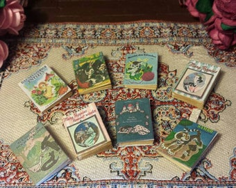 Set of 8 vintage 1.12 scale  German children's story books with aged blank turnable pages and book mark.