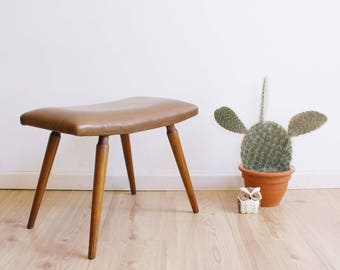 Vintage footstool with Brown skai leather. Wooden retro stool/process engineer