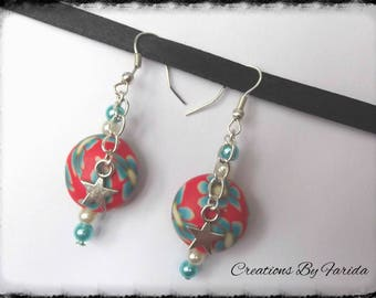 Earrings with floral flat bead and star charm
