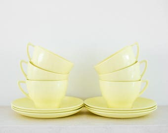 Pale Yellow Plastic Cups and Saucers