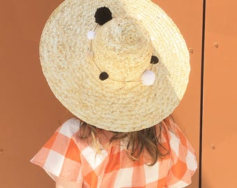 Hand woven straw hat with removable pom poms, black and white pom poms, travel hat, straw hat, sun hat, Folk Fortune, raffia black and white