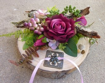 Natural artificial flowers on a wood log wedding ring cushion