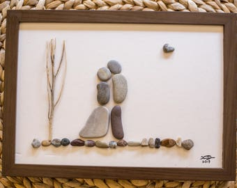 Cute couple made with pebbles