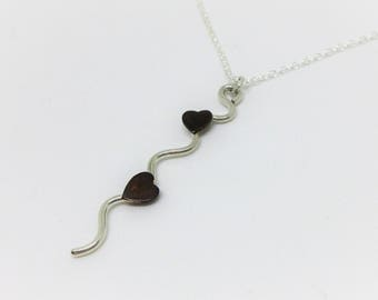 Silver Necklace with Copper Hearts