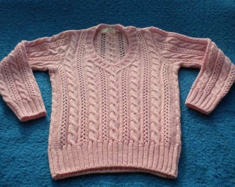 Bright pink sweater made entirely of irons with braids and pierced stitch