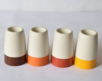 Set Of Four Tupperware Egg Cups With Coloured Covers Unused