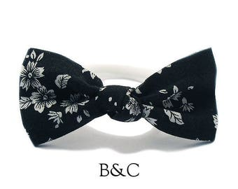 Hair bow tied black Liberty.