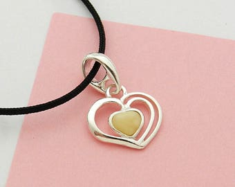 Amber and silver heart on black cord necklace