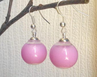 Earrings with pink liquid filled glass, silver plated findings.