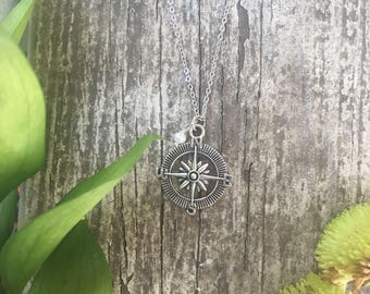 silver compass necklace.