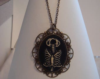 with a ribcage cameo pendant