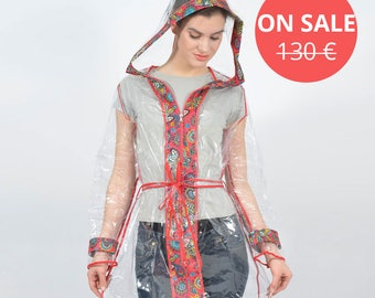 A transparent raincoat - Red border with abstract flowers