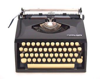 Tippa S Typewriter, Adler typewriter, Grundig typewriter, black typewriter, working state, working typewriter, portable typewriter, qwerty.