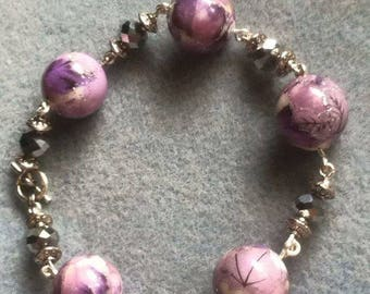 purple and silver vintage and silver rondelle beads wire bracelet with a toggle clasp.