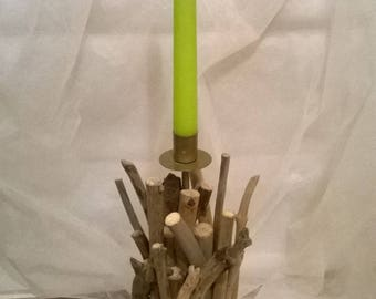 Driftwood on the base and metal candle holder