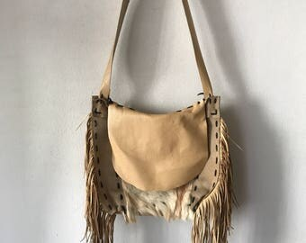 Hand made fur and leather shoulder bag made in USA .