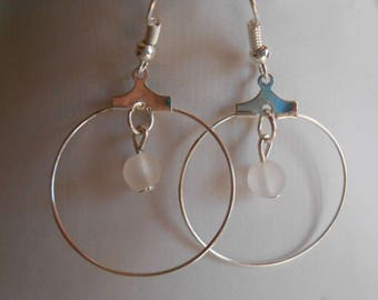 Mini hoops with their white beaded heart
