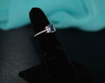 Sterling silver ring with blue topaz colored CZ