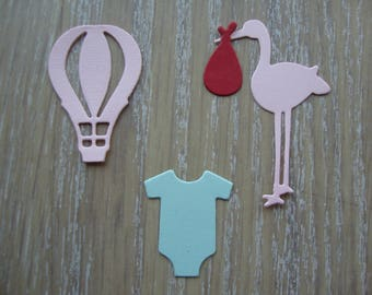 Cuts of papers for cards, baby photo album embellishments