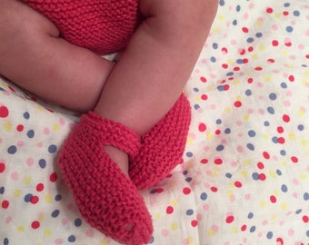 Hand knitted baby booties and diaper cover.