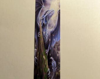 Blue fantasy dragon sitting on a tree top starring at the moon bookmark
