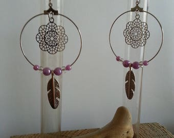 Earrings, purple feathers and rosettes