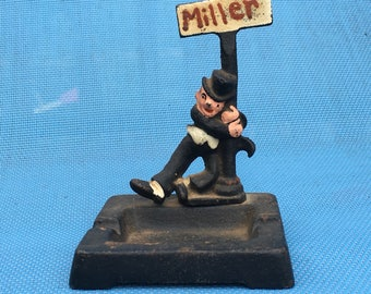 Drunk Man Hanging on Sign Street Post Miller Ashtray Cast Iron Early