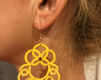 Yellow earrings to chatter