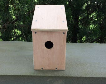 Solid wood birdhouse