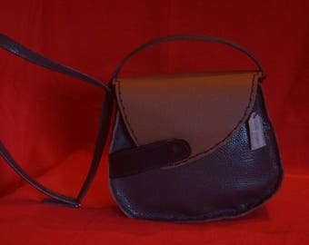 small bag shaped bag in leather