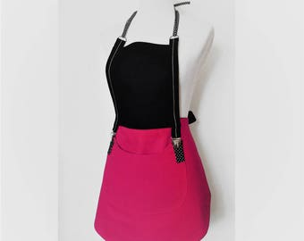 Beautiful woman in pink and black apron