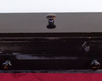 black box with 1 drawer and a lift off top