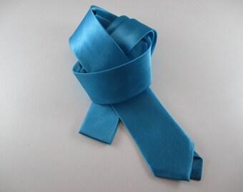 Tie, turquoise blue satin, length 145 cm x width 4.5 cm.