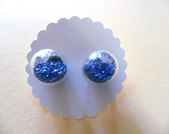 Earrings made of glass balls with blue glitter