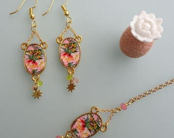 Earrings dangle and tropical flowers.