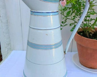 A vintage French enamelware water pitcher. Large blue, gold and white jug, home or garden decor.
