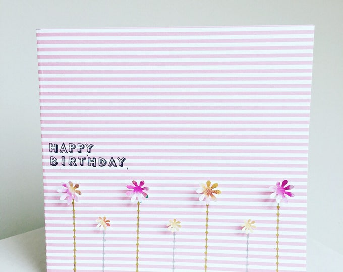 Happy birthday card, flower design on pink and white striped background