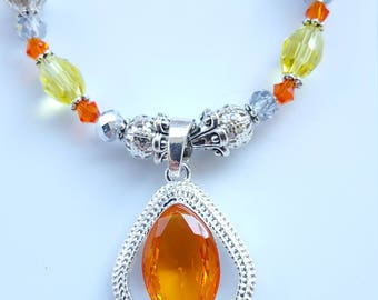 Lovely handmade Corrine and Sterling silver pendant. Swarvoski crystals, German glass.
