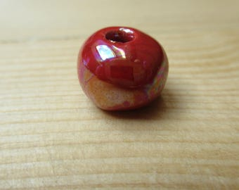 Iridescent 12 mm red ceramic bead