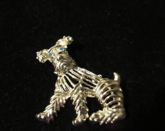 Sweet vintage dog (terrier) silver tone brooch / pin. This precious thing has a curious look on his face with emerald colored stone eyes.