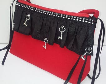 508 evening bag red crepe ruffle on the front with lace and silver color key is closed with