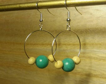 hoop earrings in silver with turquoise beads and white broken.