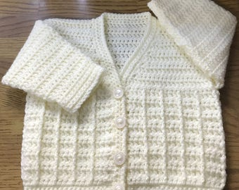Printed Baby Crochet Cardigan Pattern in DK. (Made in one piece to armholes). Sizes: Birth to 6 years (1015)