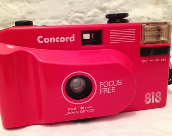 Trendy Concord 818 35mm. film camera. Collectables/Big red/Photography/cameras 35mm camera/