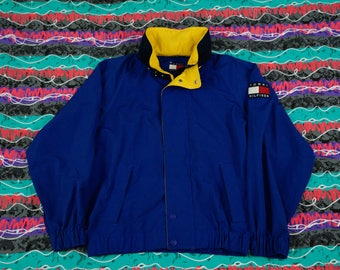 Vintage 90s Tommy Hilfiger Sailing Jacket with Pack-able Hood Size L Big Flag Spellout Colorblocking Blue
