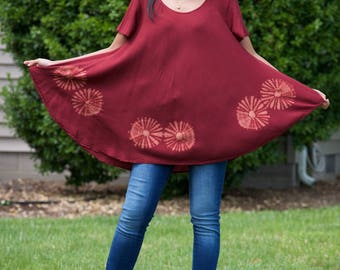 Top tunic featuring with 6 fresh water pearls