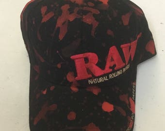 Red paint splattered RAW Hat