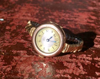 Montre en plaqué or rose 9 ct - 9 ct pink gold-plated woman watch