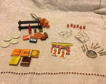 Doll House bench, sewing supplies, forks, knives, spoons, plate, platter, money, books, food. Such tiny treats. Over 50 pieces.